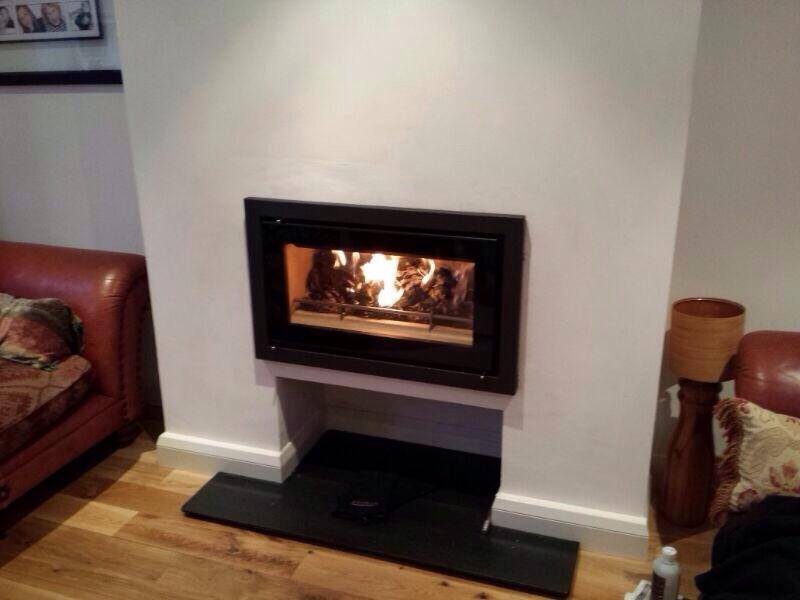 Riva inset fitted over log store
